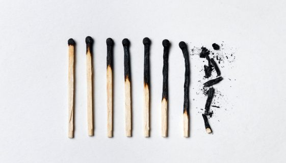 Concept of patience. A row of burnt matches, from left to right, from almost a whole match to a completely burnt match to the dust.